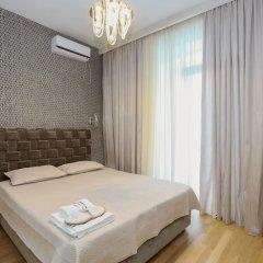 Апартаменты Hosthub - 2BR Super view Apartment Тбилиси комната для гостей