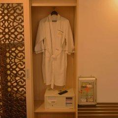 Отель Golden Cyclo Ханой сейф в номере