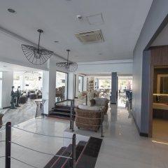 Отель Flora Garden Beach Club - Adults Only интерьер отеля