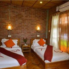 Teak Wood Hotel комната для гостей