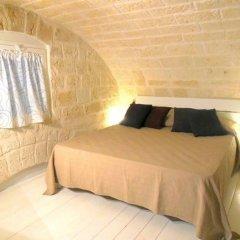 Отель Typical Apulian Apartment Италия, Бари - отзывы, цены и фото номеров - забронировать отель Typical Apulian Apartment онлайн комната для гостей фото 2