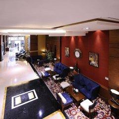 Отель Al Hamra Palace By Warwick питание