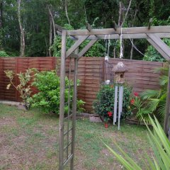 Отель Bungalow With one Bedroom in Guadeloupe, With Pool Access, Enclosed Ga фото 2
