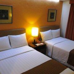 Отель Makati Crown Regency Hotel Филиппины, Макати - отзывы, цены и фото номеров - забронировать отель Makati Crown Regency Hotel онлайн комната для гостей фото 3