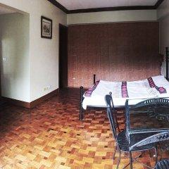 Отель MC Mountain Home Apartelle Филиппины, Тагайтай - отзывы, цены и фото номеров - забронировать отель MC Mountain Home Apartelle онлайн комната для гостей