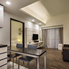 Апартаменты Orange Grove Service Apartment by ST Residences комната для гостей фото 3