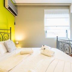 Отель Stylish Apartment with Balcony Греция, Афины - отзывы, цены и фото номеров - забронировать отель Stylish Apartment with Balcony онлайн комната для гостей фото 4