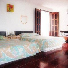 Отель Plaza Carrillo's Мексика, Канкун - отзывы, цены и фото номеров - забронировать отель Plaza Carrillo's онлайн комната для гостей