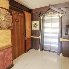 Отель Arman Residence сейф в номере