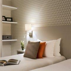 Отель Citadines Montmartre Paris сейф в номере