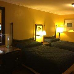 Отель Dragon Inn & Suites комната для гостей