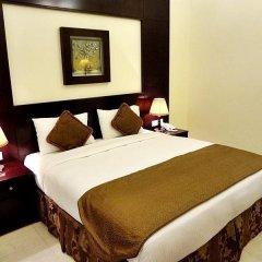 Arabian Dreams Deluxe Hotel Apartments сейф в номере