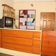 Отель Xcape Hotels and Suites Ltd Нигерия, Калабар - отзывы, цены и фото номеров - забронировать отель Xcape Hotels and Suites Ltd онлайн интерьер отеля
