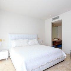 Отель Luxury Condos at Magia Мексика, Плая-дель-Кармен - отзывы, цены и фото номеров - забронировать отель Luxury Condos at Magia онлайн комната для гостей фото 3
