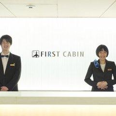 Отель First Cabin Kyobashi фитнесс-зал