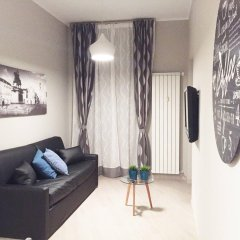 Апартаменты Torino Suite комната для гостей
