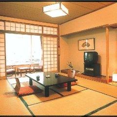 Отель Hanabishi Hotel Япония, Хита - отзывы, цены и фото номеров - забронировать отель Hanabishi Hotel онлайн интерьер отеля