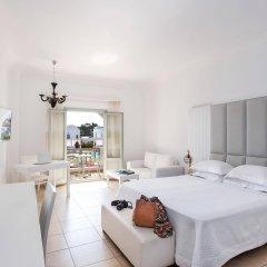 Astro Palace Hotel & Suites комната для гостей