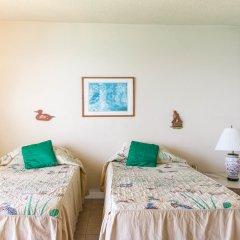 Отель Sky Box Beach Suite at Montego Bay Club Ямайка, Монтего-Бей - отзывы, цены и фото номеров - забронировать отель Sky Box Beach Suite at Montego Bay Club онлайн комната для гостей фото 3