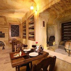 Отель Kayakapi Premium Caves - Cappadocia в номере фото 2