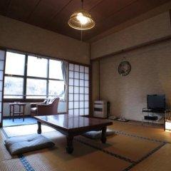 Отель Yamanoyado Reisen Kannojigoku Ryokan Минамиогуни комната для гостей фото 4