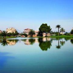 Отель Apartamentos Y Villas Oliva Nova Golf Олива приотельная территория