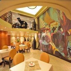 Отель Miramar Hotel Филиппины, Манила - отзывы, цены и фото номеров - забронировать отель Miramar Hotel онлайн гостиничный бар