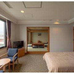 Отель Seaside Hotel Yakushima Япония, Якусима - отзывы, цены и фото номеров - забронировать отель Seaside Hotel Yakushima онлайн комната для гостей