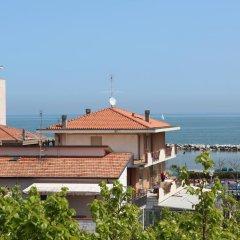 Отель Residence Cigno Италия, Римини - отзывы, цены и фото номеров - забронировать отель Residence Cigno онлайн пляж