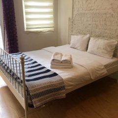 Отель Mayer Sahkulu Suites Стамбул комната для гостей