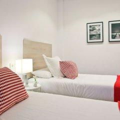 Апартаменты Feelathome Madrid Suites Apartments комната для гостей фото 2