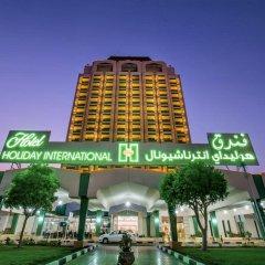 Отель Holiday International Sharjah ОАЭ, Шарджа - 5 отзывов об отеле, цены и фото номеров - забронировать отель Holiday International Sharjah онлайн вид на фасад
