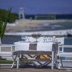 Отель Oasis Beach Hotel Греция, Агистри - отзывы, цены и фото номеров - забронировать отель Oasis Beach Hotel онлайн гостиничный бар