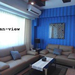 Отель La Mirada Residences Филиппины, Лапу-Лапу - отзывы, цены и фото номеров - забронировать отель La Mirada Residences онлайн комната для гостей фото 3