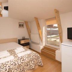 Апартаменты Дерибас Стандартный номер с различными типами кроватей фото 17