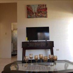Отель Timeless Vacation Home Ямайка, Монтего-Бей - отзывы, цены и фото номеров - забронировать отель Timeless Vacation Home онлайн удобства в номере фото 2