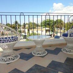 Отель Villa Capri Salon & SPA Доминикана, Бока Чика - отзывы, цены и фото номеров - забронировать отель Villa Capri Salon & SPA онлайн балкон