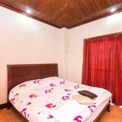Отель MC Mountain Home Apartelle Филиппины, Тагайтай - отзывы, цены и фото номеров - забронировать отель MC Mountain Home Apartelle онлайн комната для гостей фото 5