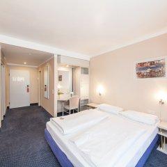 Отель Novum Hotel Koe Dusseldorf Германия, Дюссельдорф - 2 отзыва об отеле, цены и фото номеров - забронировать отель Novum Hotel Koe Dusseldorf онлайн комната для гостей фото 2