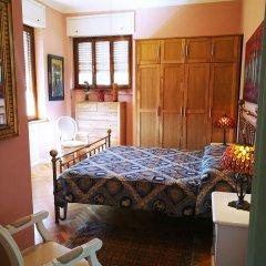 Апартаменты Villa DaVinci - Garden Apartment Вербания комната для гостей фото 5