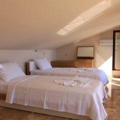 Villa Doruk by Akdenizvillam Турция, Калкан - отзывы, цены и фото номеров - забронировать отель Villa Doruk by Akdenizvillam онлайн комната для гостей