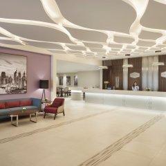 Отель Hampton by Hilton Dubai Airport интерьер отеля