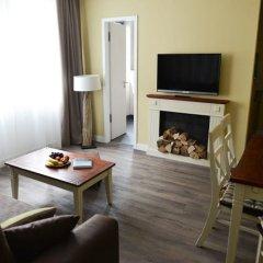 Апартаменты Apartment Central комната для гостей фото 5