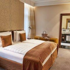 Hotel Vier Jahreszeiten Kempinski München комната для гостей фото 3