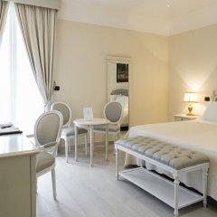 Отель Sangiorgio Resort & Spa Кутрофьяно комната для гостей фото 8