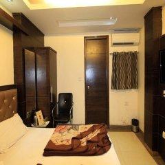 Отель Chander Palace в номере фото 2