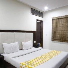 Отель OYO 16011 Hotel Mohan International Индия, Нью-Дели - отзывы, цены и фото номеров - забронировать отель OYO 16011 Hotel Mohan International онлайн комната для гостей фото 4