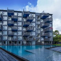 Отель The Deck Condo Patong