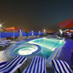 Отель Rolla Residence Hotel Apartment ОАЭ, Дубай - отзывы, цены и фото номеров - забронировать отель Rolla Residence Hotel Apartment онлайн бассейн фото 2