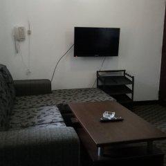 Апартаменты Everglow Apartment удобства в номере фото 2